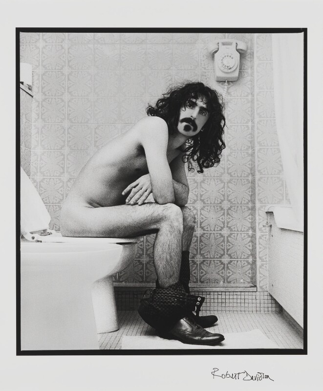 Frank Zappa sitting on the toilet