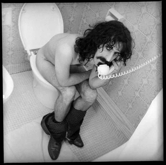 Frank Zappa on the toilet; holding phone - Robert Davidson photography