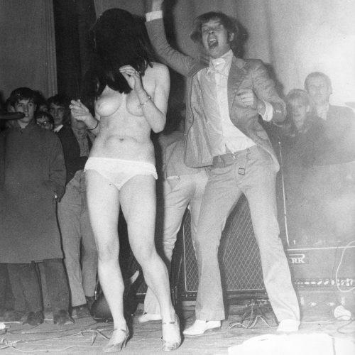 Trevor Burton with topless stripper - © Robert Davidson Photography