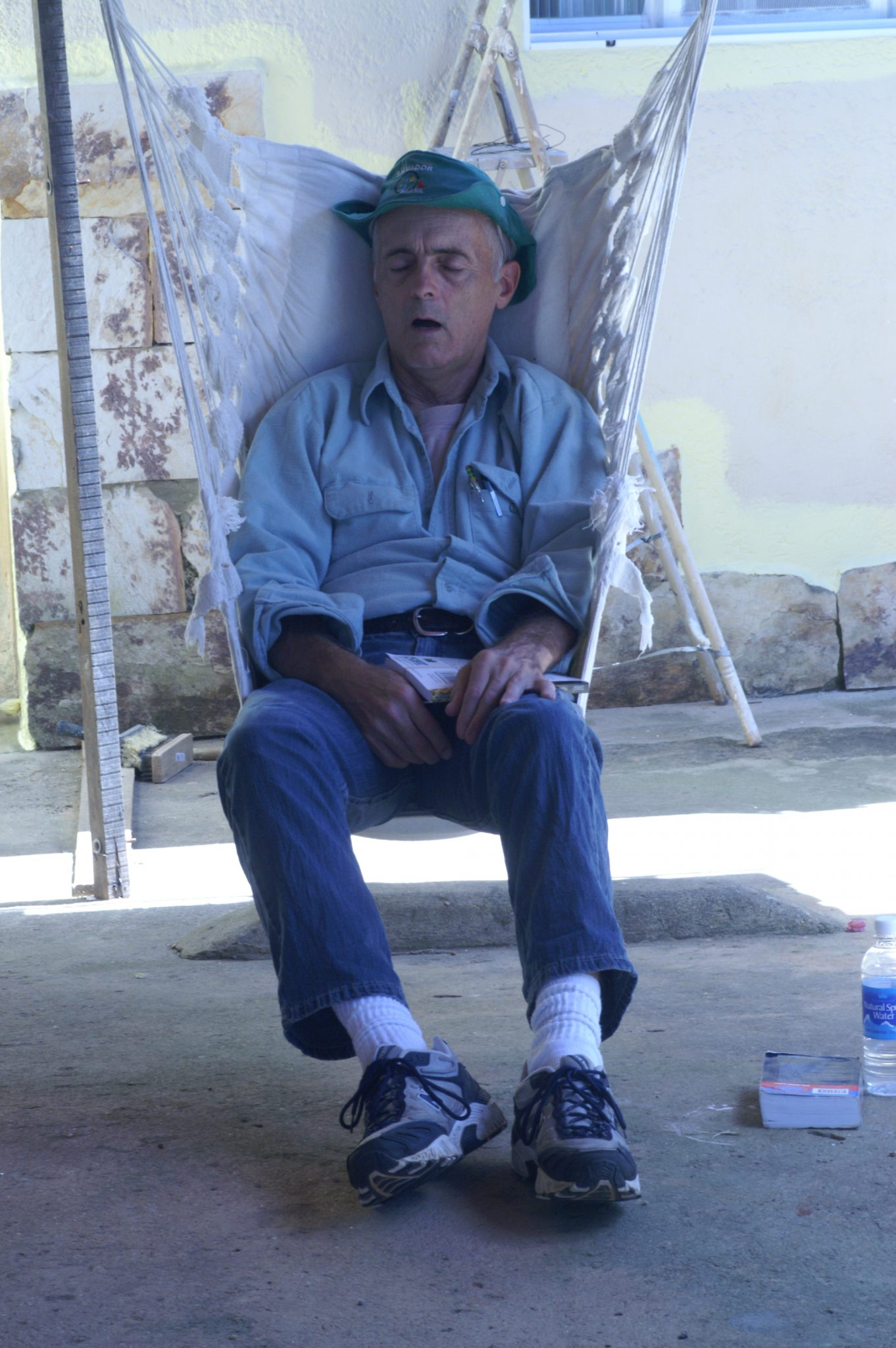 Man sleeping in hammock chair