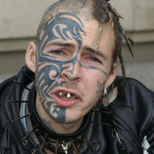 Man with facial tattoo